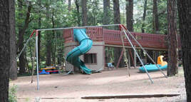Northwoods Cabins Pinetop Arizona Resort  has  a Playground for the Kiddos