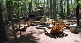 Northwoods Cabins Pinetop Arizona Resort  has  a Fire Pit and Outdoor Grilling Area